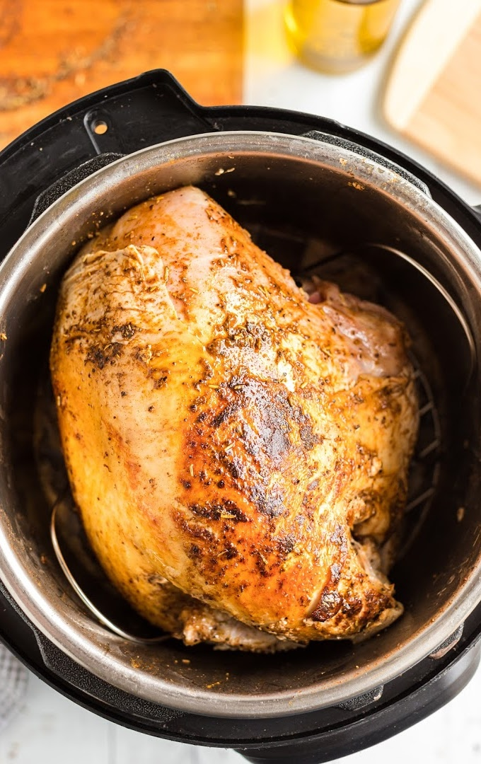overhead shot of instant pot turkey breast in a crockpot