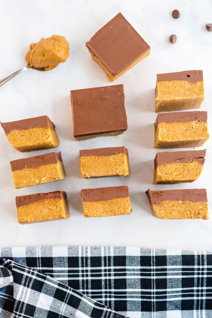 no bake peanut butter bars lined on table