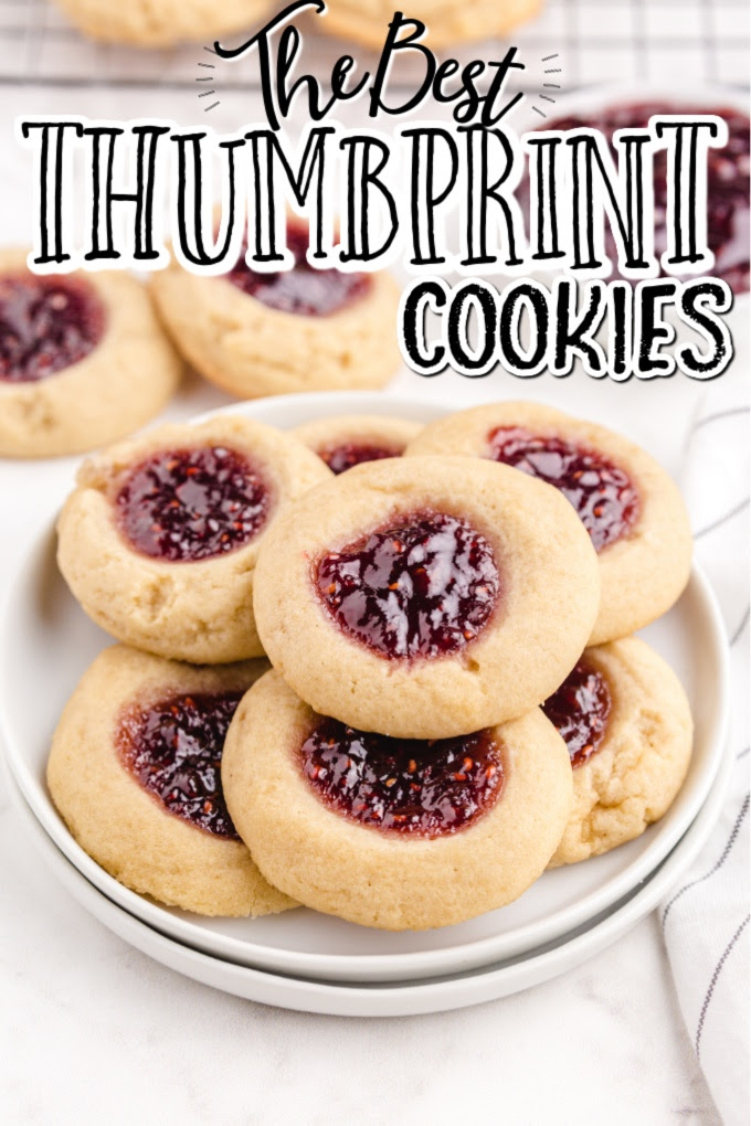 thumbprint cookies of cookies being stacked on top of each other and placed on a white plate