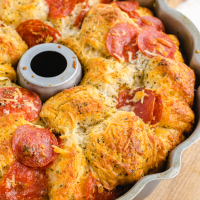 close up shot of pull apart pizza bread in a cake pan