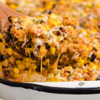 close up shot of Mexican beef and rice casserole being picked up with a spatula from a baking pan