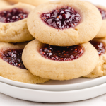 close up shot of thumbprint cookies on a white plate