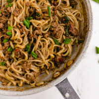close up shot of Mongolian beef and noodle in a pan