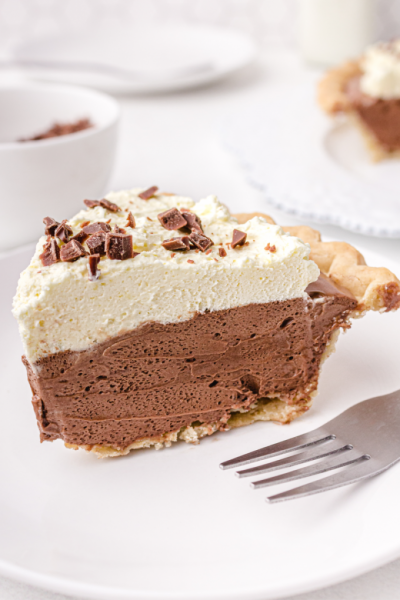 close up shot of a slice of french silk pie on a white plate