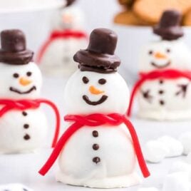 close up shot of snowmen truffles with mini marshmallows and mini Oreos