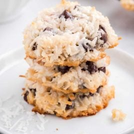 close up shot of Almond Joy Cookies stacked on top of each other