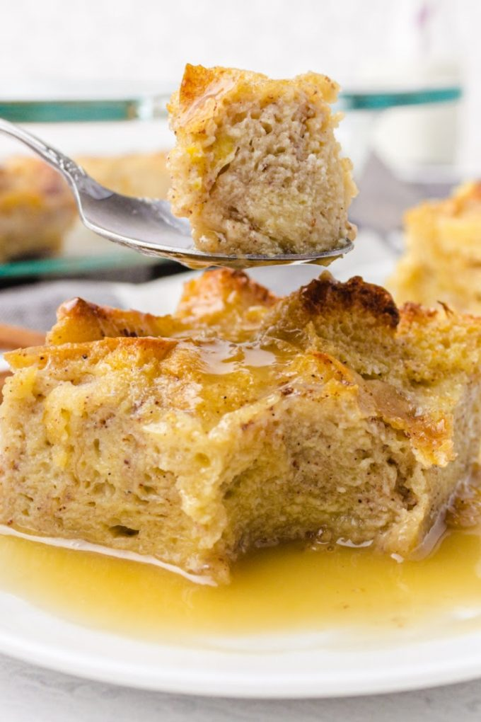 close up shot of bread pudding on a white plate