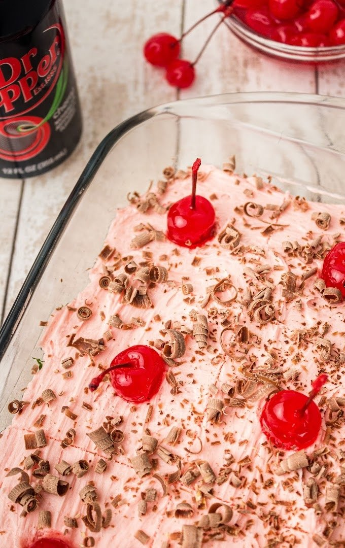 close up shot of cherry dr pepper cake in a Clear baking pan