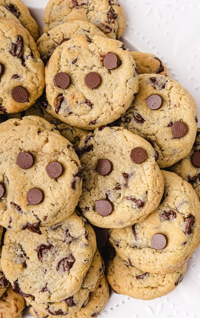 close up shot of cream cheese chocolate chip cookies stacked on top of each other