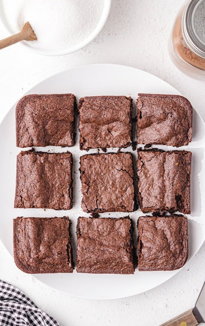 close up shot of egg white brownies on a white plate