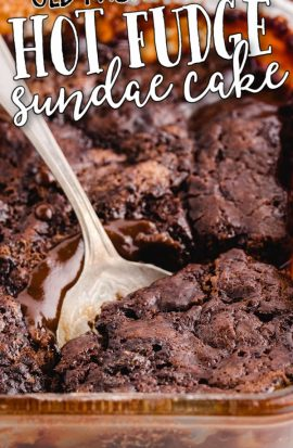 close up shot of hot fudge sundae cake in a clear baking pan
