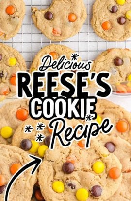 close up overhead shot of Reese's cookies piled on top of each other and on a baking sheet
