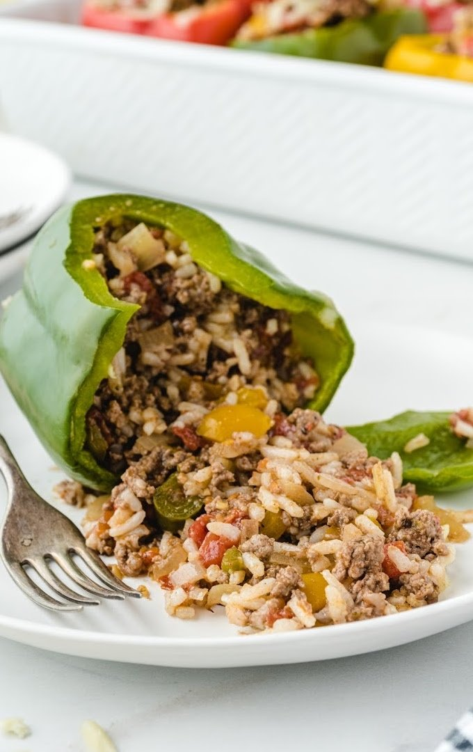 close up shot of stuffed peppers on a white plate