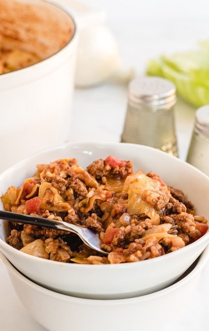 close up shot of unstuffed cabbage rolls in a white bowl