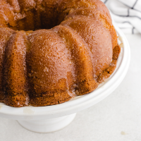 close up shot of kentucky butter cake on a white stand
