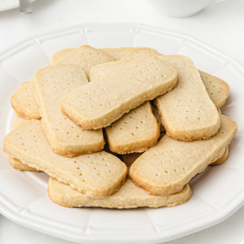 close up shut of shortbread cookies on a white plate
