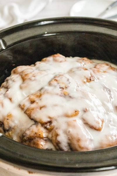 close up shot of slow cooker cinnamon roll casserole in a crockpot