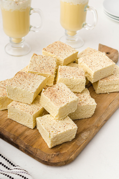 eggnog fudge piled on top of each other on a wooden board