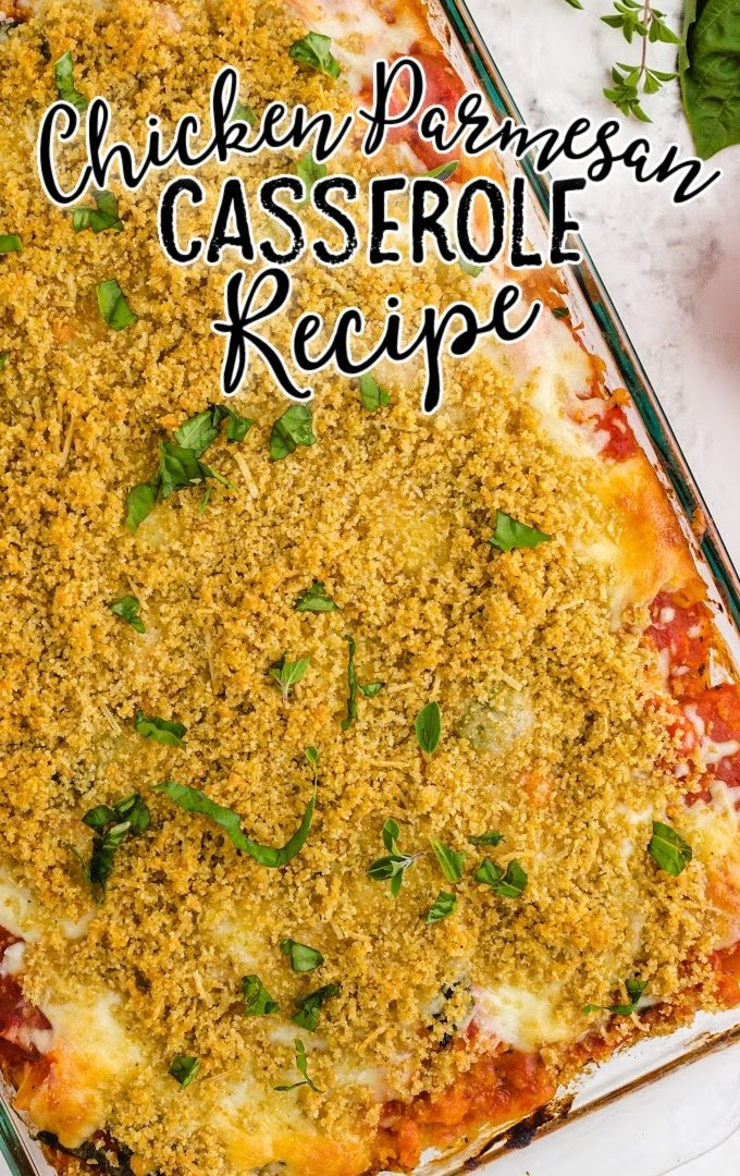 close up shot of chicken parmesan casserole in a white baking dish