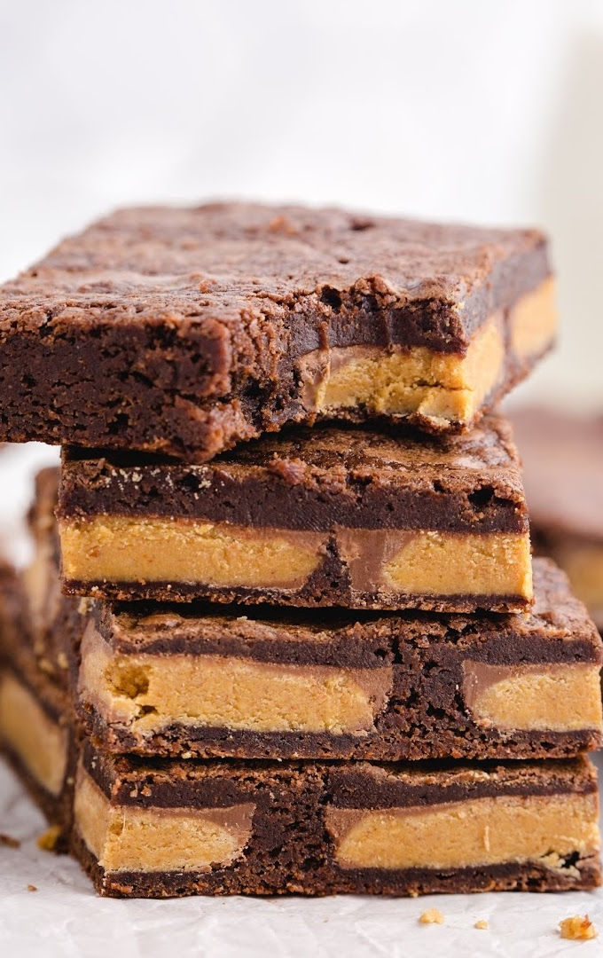 close up shot of chocolate peanut butter brownies stacked on top of each other