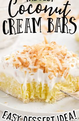 close up shot of coconut cream bars on a white plate