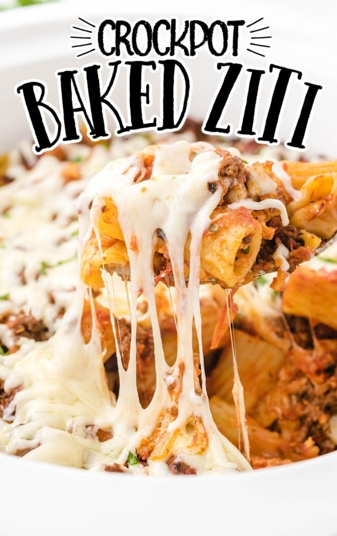 close up shot of crockpot baked ziti topped with cheese in a crockpot being picked up with a spoon