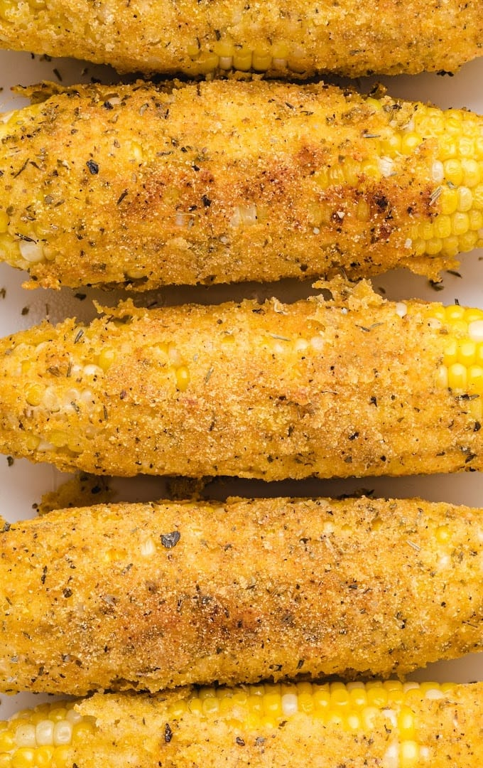 close up overhead shot of fried corn on the cob lined on a plate