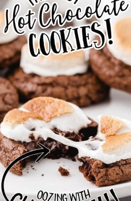 close up shot of hot chocolate cookies being pulled apart on a white plate