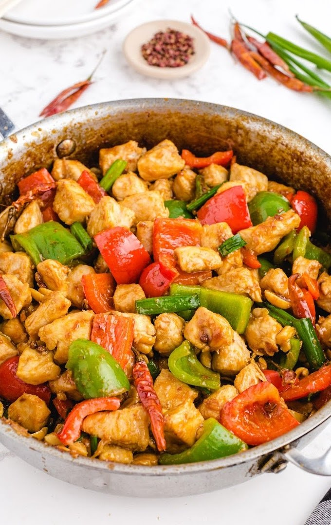 close up shot of Kung Pao chicken in a dish