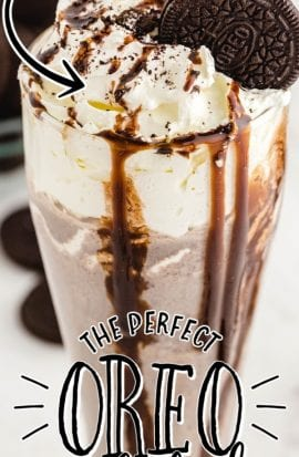 close up shot of Oreo milkshake topped with a Oreo and chocolate glaze falling down the cup