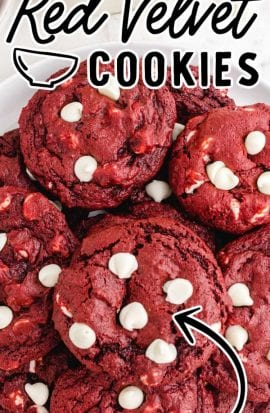 close up overhead shot of red velvet cookies with white chocolate chips stacked on top of each other on a plate