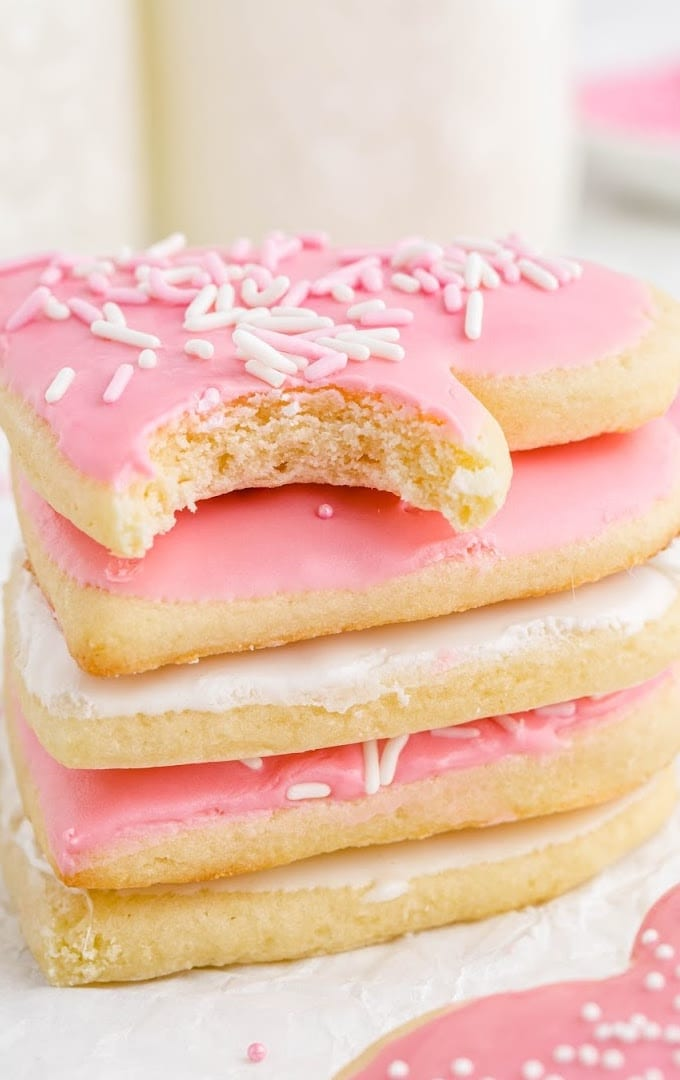 close up shot of valentine sugar cookies stacked on top of each other