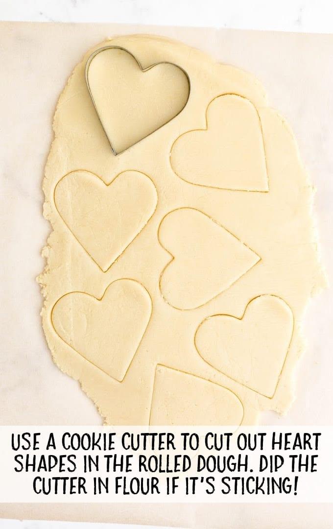 valentine sugar cookies process shot of valentine sugar cookies dough being cut