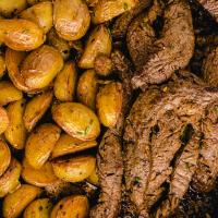 close up overhead shot of garlic butter steak and potato skillet