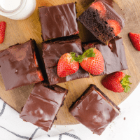 close up overhead shot of Chocolate Covered Strawberry Brownies on a wooden board