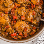 close up overhead shot of chicken cacciatore in a dish