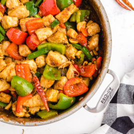 close up over head shot of Kung Pao chicken in a dish