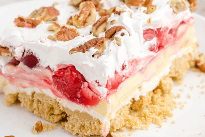 close up shot of cherry cheesecake lush on a plate