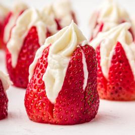 close up shot of cheesecake stuffed strawberries