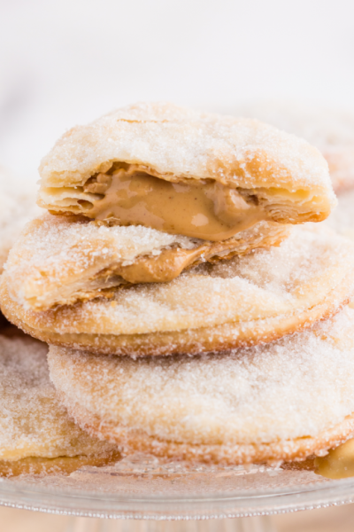 close up shot of peanut butter lava cookies piled on top of each other