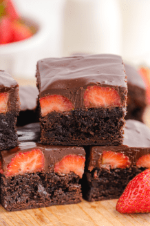 close up shot of Chocolate Covered Strawberry Brownies on a wooden board