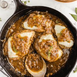 overhead shot of French onion pork chops in a dish with cheese and sauce on top