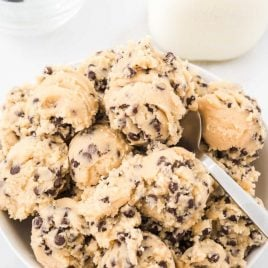close up shot of scoops of edible cookie dough in a bowl with a fork