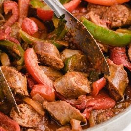 close up shot of sausage and peppers in a dish