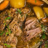 close up overhead shot of pot roast garnished with parsley