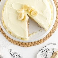 close up overhead shot of banana cake with a slice cut out on a cake tray