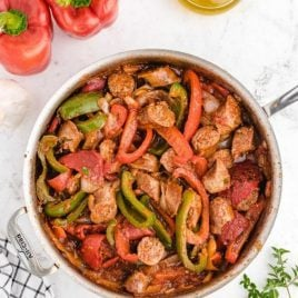 close up overhead shot of sausage and peppers in a pot