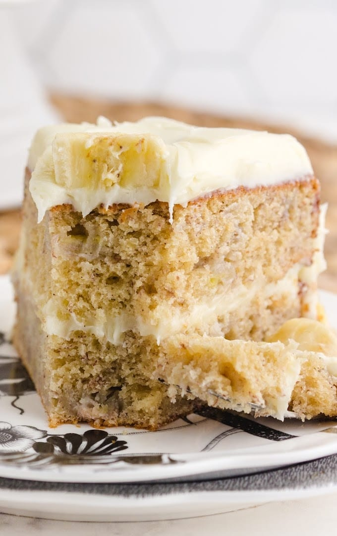 close up front shot of a slice of banana cake on a plate