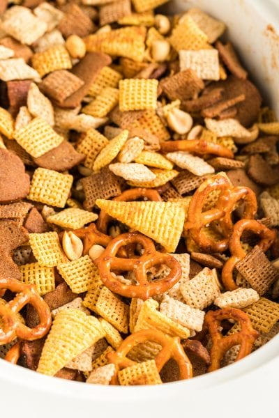 close up overhead shot of Crockpot Chex Mix in a white crockpot