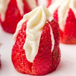 close up side shot of Cheesecake Stuffed Strawberries